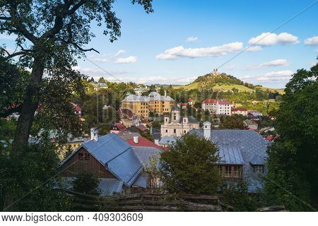 View Of Banska Stiavnica Historic Town Centre With Mining Academy Building And The Baroque Calvary O