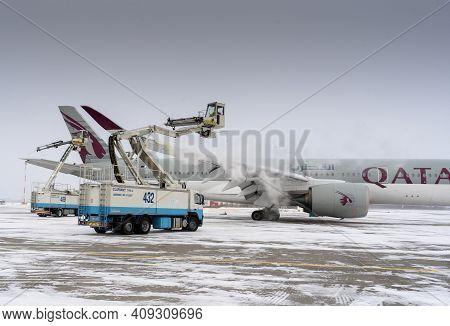 Ukraine, Kyiv - February 12, 2021: De-icing The Aircraft Before The Flight. The Deicing Machine. Pas