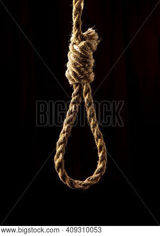 Loop With Strong Rope On Black Isolated Background. Formerly Used For Executions In Camps