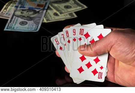 Poker Cards With A Straight Flush Combination. Closeup Of Gambler Hand Is Holding Playing Cards In C