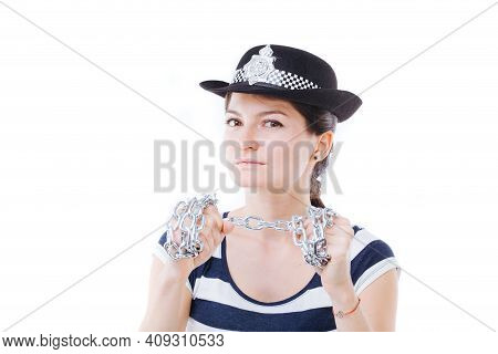 Young Woman Posing As Fearless Policewoman, Holding Chains