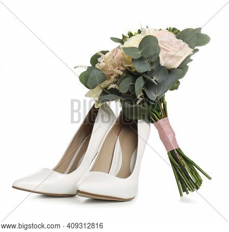 Pair Of Wedding High Heel Shoes And Beautiful Bouquet On White Background
