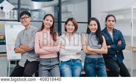 Group Of Asia Young Creative People In Smart Casual Wear Smiling And Arms Crossed In Creative Office