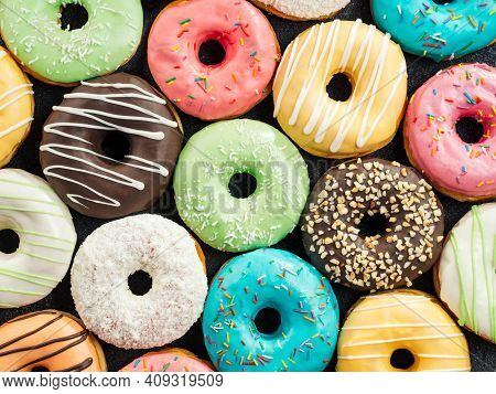 Donuts Pattern. Top View Of Assorted Glazed Donuts. Colorful Donuts With Icing As Background With Co