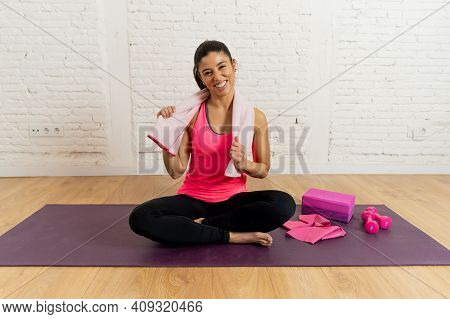 Portrait Of Attractive Active Woman In The Gym Or At Home Exercising