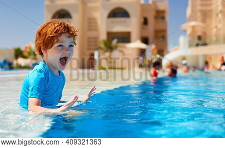 Excited Kid, Toddler Boy Having Fun In The Pool, Summer Water Activity