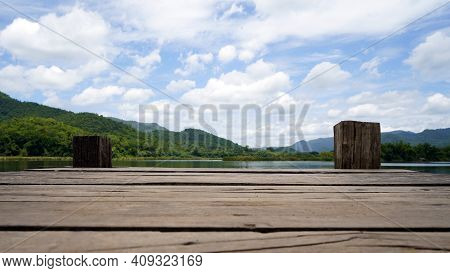 Panoramic View Of Wooden Bridge Lake With Green Mountain, Bright Blue Sky And Lake At The Background