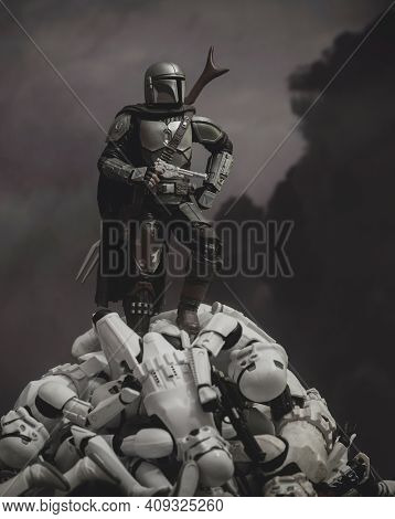 FEB 20 2021:Star Wars The Mandalorian Din Djarin ontop of a  pile of defeated Stromtroopers - Hasbro action figure