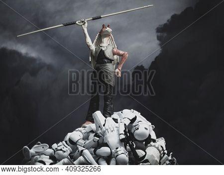 FEB 20 2021: Star Wars humor, Jar Jar Binks on top of a pile of defeated Stromtroopers - Hasbro action figure
