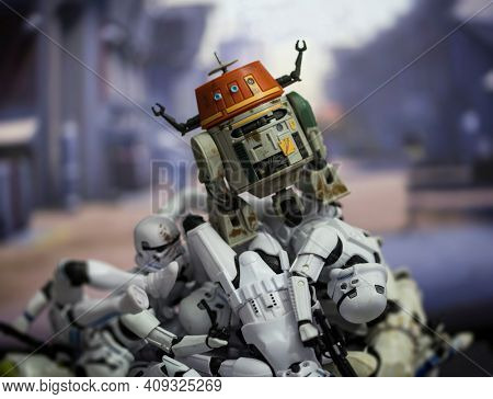 FEB 20 2021: Star Wars humor, astromech droid CH-1P Chopper ontop of a pile of defeated Stromtroopers - Hasbro action figure