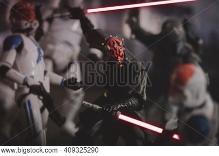 FEB 20 2021: Scene from Star Wars The Clone Wars season 7 with Darth Maul fighting in the siege of Mandaloere - Hasbro action figure