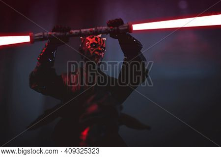 FEB 20 2021: Sith lord Darth Maul  wielding his double blade lightsaber - Hasbro action figure