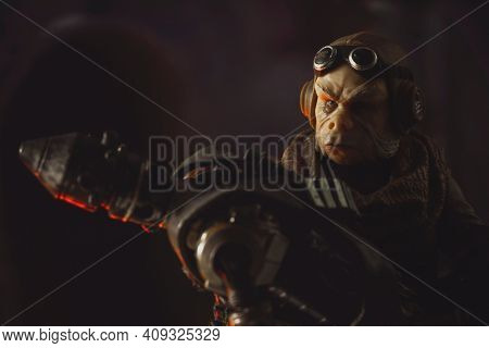 FEB 20 2021: scene from Star Wars The Mandaloran with Ugnaught Kuiil holding the dead assassin droid IG-11- Hasbro action figure