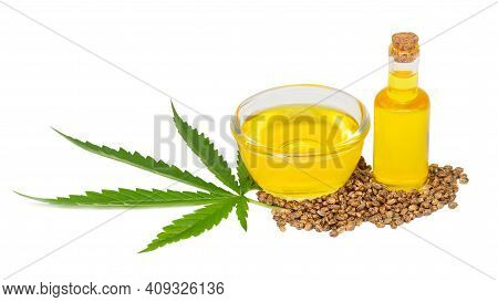 Cannabis (marijuana, Hemp) Oil In A Glass Cup And Cannabis Seeds Isolated On White Background, Cbd,
