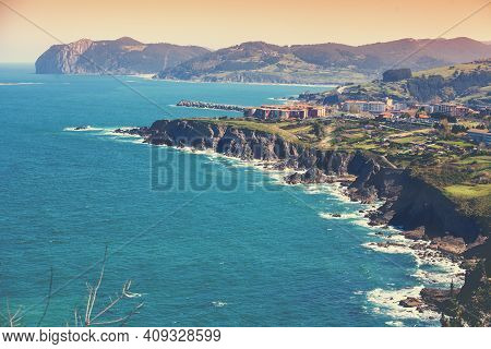 Panoramic View Of The Rocky Seashore. Aerial View Of A Steep Coast With Bermeo City. Bay Of Biscay,