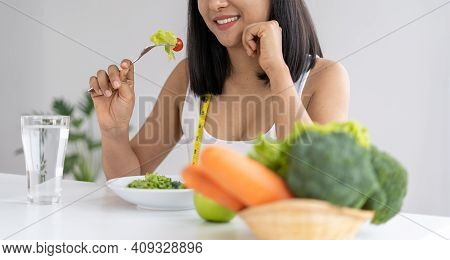 Beautiful Asian Women Are Enjoying Eating Salad To Lose Weight. Healthy Young Woman Eating Vegetable