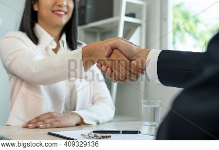 A Close Up Of Two Business Holding Hands, Agreeing To Work Together, Or Congratulating Each Other. B