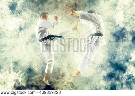 Martial arts masters, karate practice. Smoke background