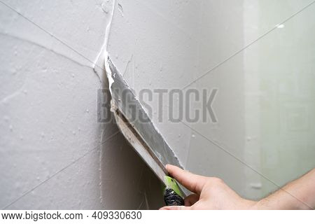 The Process Of Applying Layer Of Putty Trowel For Light Plaster Walls