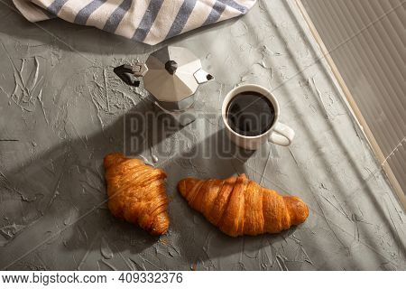 Breakfast With Croissant And Coffee And Moka Pot. Morning Meal And Breakfast Concept. Top View.