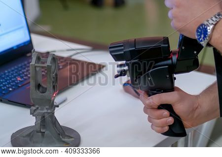 Close Up View Of Man Hand Holding Handheld 3d Scanner For Capturing Object At Modern Technology Exhi