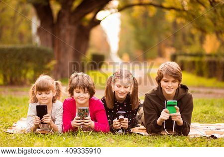 Smartphone Addiction Group Of Little Children Watching Film Movie Cartoon Together On Digital Tablet