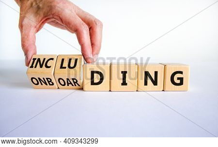 Onboarding And Including Symbol. Businessman Turns Wooden Cubes And Changes The Word 'onboarding' To