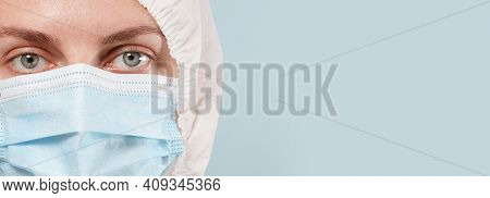 Caucasian Doctor Or Nurse In A Special Protective Suit And Mask Looking At The Camera, Copy Space, M