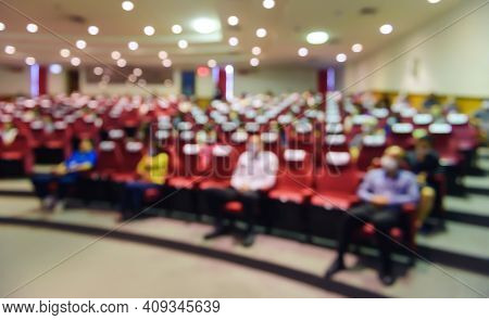 Abstract Blurred Of Put Spaces Between Attendee In Seminar Room Or Conference Hall For Social Distan