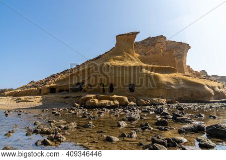 Sandstone Caves And Dwellings At An Idyllic Cove And Beach On The Coast O Murcia