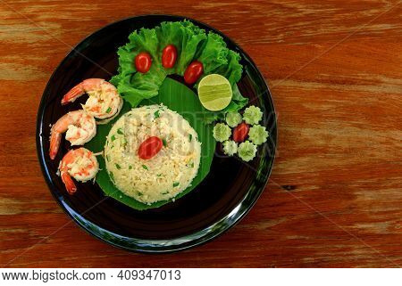 Top View Of Fried Rice With Shrimp On Black Dish