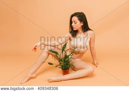 Sexy And Beautiful Woman In Underwear With Plant. Beautiful And Healthy Girl With Young And Fit Body