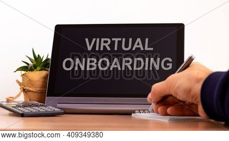 Virtual Onboarding Symbol. Tablet With Words Virtual Onboarding. Online Business And Onboarding Duri