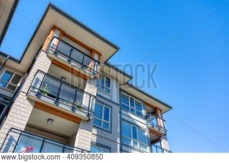 Corners Of New Residential Building On Blue Sky Background