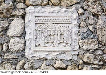Bakhchisarai, Crimea - January 25, 2021: Slab With An Ancient Carved Relief Depicting A Hunting Lion
