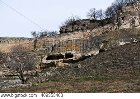 View Of The Ruins Of A Medieval Cave City-fortress On A Rocky Hilltop