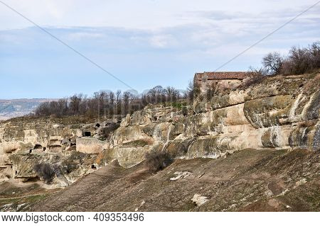 Chufut-kale, Crimea - January 25, 2021: View Of The Karaite Kenassas On The Edge Of A Cliff In The A