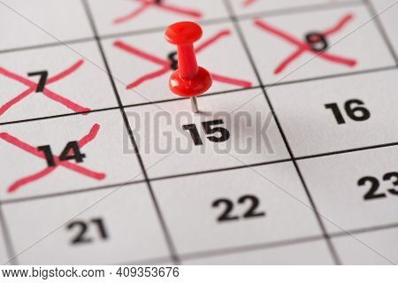 Planed Meeting Is Here Concept. Cropped Close Up View Photo Of Red Pushpin Attached To Calendar With