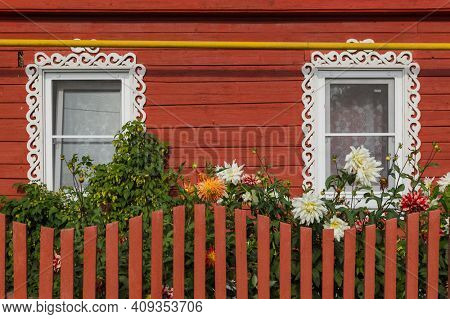 Windows in old russian wooden house - architecture background