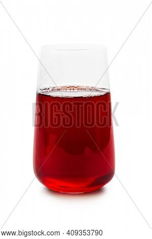 Glass of red fruit juice isolated on white background