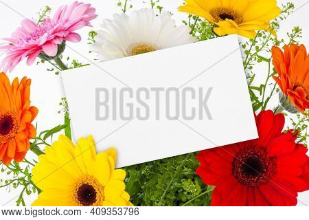 Flowers bouquet and blank greeting card - celebration background