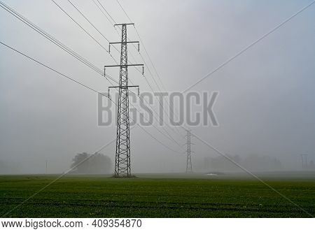 Power Line Over Agriculture Fields A Foggy Morning