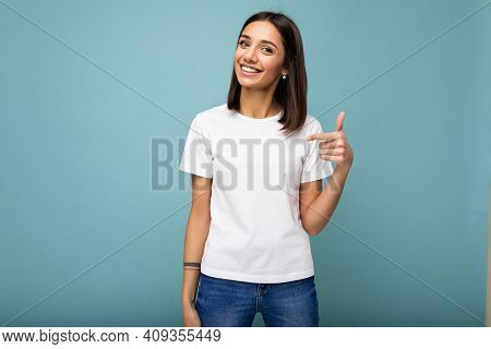 Portrait Of Young Beautiful Happy Smiling Brunette Woman Wearing Trendy White T-shirt With Empty Spa