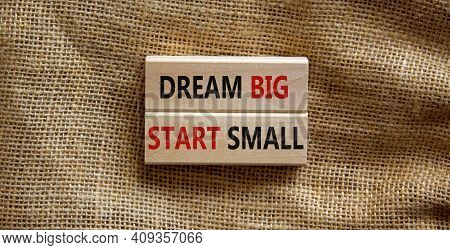 Dream Big Start Small Symbol. Concept Words 'dream Big Start Small' On Wooden Blocks On A Beautiful
