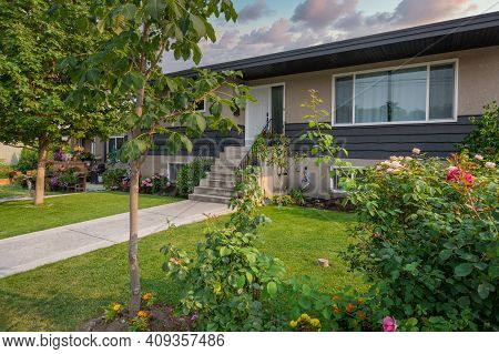 Average Family House With Concrete Pathway Over Front Yard