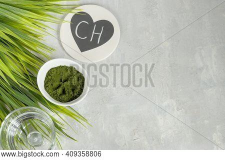 Chlorella Algae Powder On A Light Background. A Green Superfood For A Vegetarian Diet. Chalk Letteri