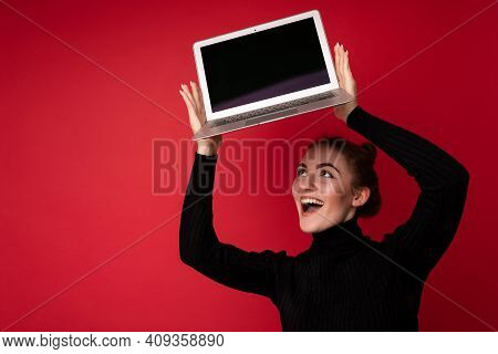 Photo Of Beautiful Smiling Happy Young Brunette Woman Holding Computer Laptop With Empty Monitor Scr