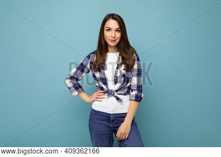 Portrait Of Positive Cheerful Fashionable Woman In Hipster Outfit Isolated On Blue Background With C