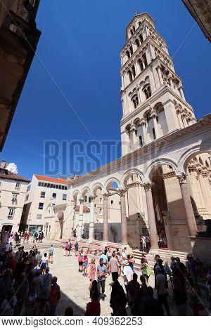 Split, Croatia - July 20, 2019: Tourists Visit The Cathedral And Diocletian Palace Area In Split. Cr