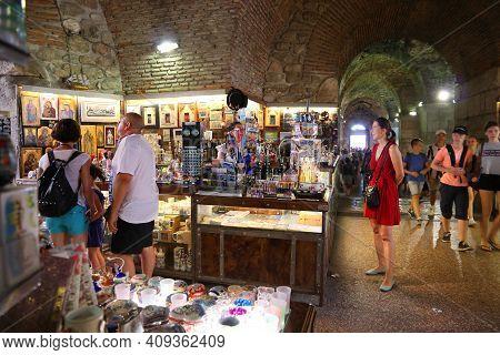Split, Croatia - July 20, 2019: Tourists Visit Underground Souvenir Market Under Diocletian's Palace